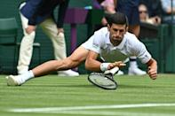 Down but not out: Novak Djokovic falls during his win over South Africa's Kevin Anderson
