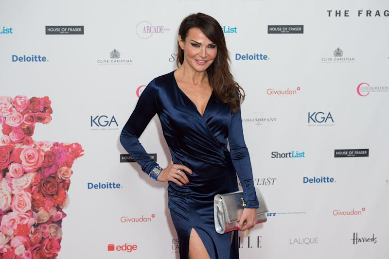 Lizzie Cundy poses for photographers upon arrival for the Fragrance Foundation Awards at a central London venue, Thursday, May 14, 2015. (Photo by Jonathan Short/Invision/AP)