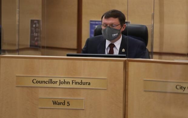 Coun. John Findura, shown here at a 2020 council meeting, defended the Regina Public Library's request for an increase.