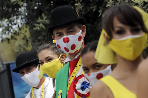Tour de France hostess wear face masks prior to the start of the first stage of the Tour de France cycling race over 156 kilometers (97 miles) with start and finish in Nice, southern France, Saturday, Aug. 29, 2020. (AP Photo/Christophe Ena)