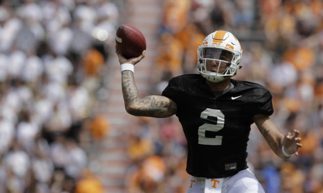 Staff photo by C.B. Schmelter / Orange team quarterback Jarrett Guarantano (2) throws on the run during the Orange and White spring game at Neyland Stadium on Saturday, April 21, 2018 in Knoxville, Tenn. (C.B. Schmelter /Chattanooga Times Free Press via AP)