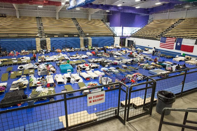 Hurricane Harvey evacuees rest at the Delco Center in East Austin (AFP Photo/SUZANNE CORDEIRO)