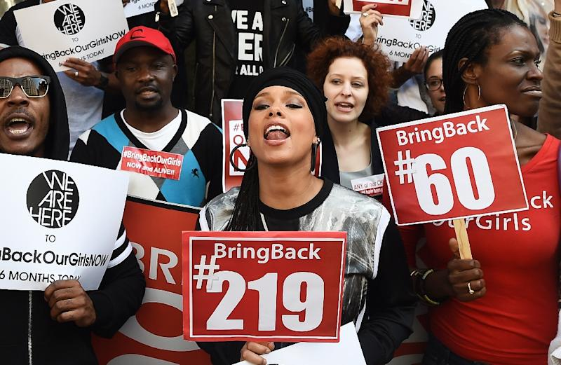 """US singer-songwriter Alicia Keys (C) joins protesters with the """"Bring Back Our Girls"""" campaign during a demonstration in front of the Nigerian consulate in New York on October 14, 2014, to mark the six month anniversary of the kidnapping"""