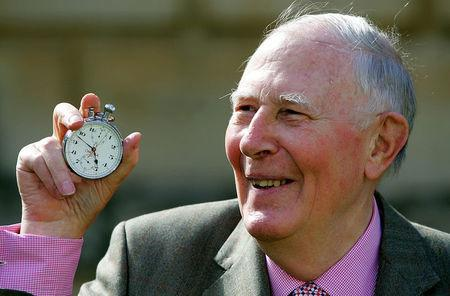 FILE PHOTO: Sir Roger Bannister, who ran the first sub-four-minute mile in 1954, holds the stop watch used by Harold Abrahams to time the race during 50th anniversary celebrations at Pembroke College, Oxford, May 6, 2004. REUTERS/David Bebber/File Photo
