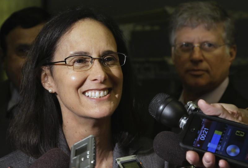 FILE - In this April 15, 2013 file photo, Illinois Attorney General Lisa Madigan speaks to reporters during a news conference in Springfield Ill. Madigan, a Democrat is considering a run for governor in 2014. A Madigan candidacy would raise questions about whether it would concentrate too much power in one family. Her father, Michael Madigan, is in his 28th year as Speaker of the House and is also chairman of the Illinois Democratic party. (AP Photo/Seth Perlman)