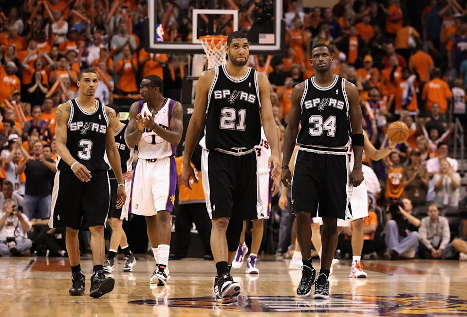<p>2010: George Hill #3, Tim Duncan #21 and Antonio McDyess #34 of the San Antonio Spurs react as Amar'e Stoudemire #1 and the Phoenix Suns celebrate in the final moments of Game One of the Western Conference Semifinals of the 2010 NBA Playoffs at US Airways Center on May 3, 2010 in Phoenix, Arizona.</p>