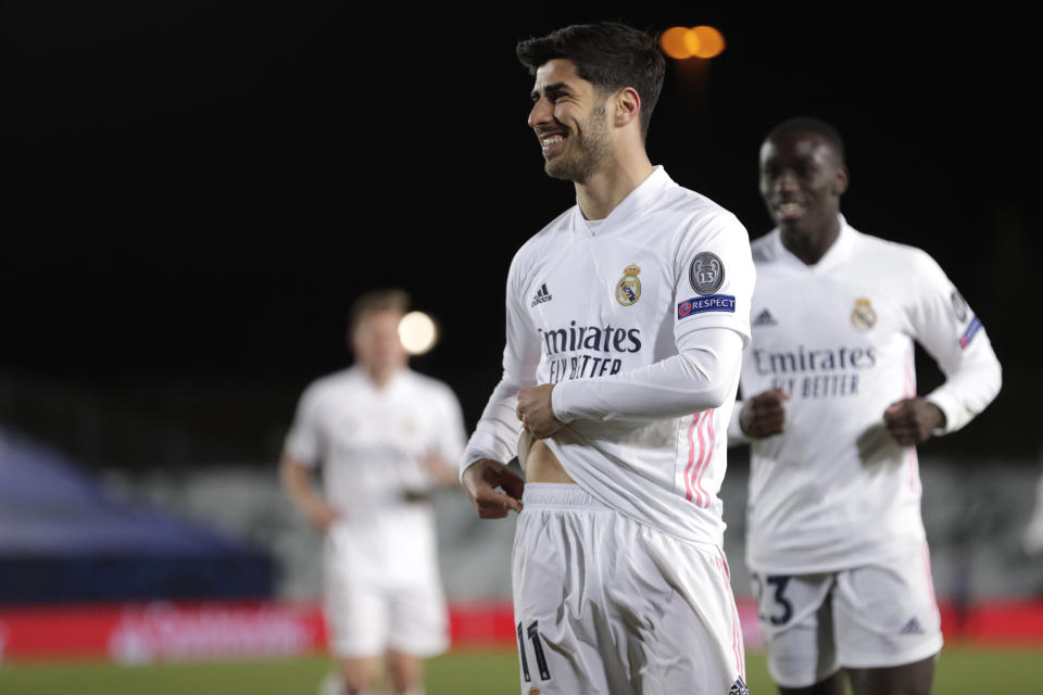 Real Madrid's Marco Asensio celebrates scoring his side's 3rd goal during the Champions League, round of 16, second leg soccer match between Atalanta and Real Madrid at the Alfredo di Stefano stadium in Madrid, Spain, Tuesday, March 16, 2021. (AP Photo/Bernat Armangue)