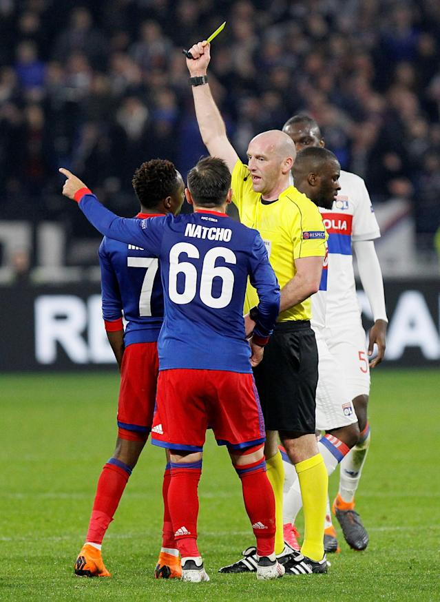 Soccer Football - Europa League Round of 16 Second Leg - Olympique Lyonnais vs CSKA Moscow - Groupama Stadium, Lyon, France - March 15, 2018 CSKA Moscow's Ahmed Musa is shown a yellow card by referee Bobby Madden REUTERS/Emmanuel Foudrot
