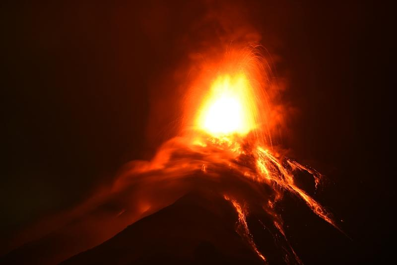 Volcano of Fire erupts, spewing lava and ash into the air