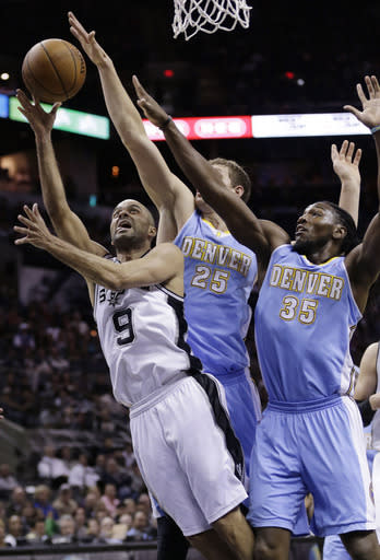 San Antonio Spurs' Tony Parker (9) scores past Denver Nuggets' Timofey Mozgov (25) and Kenneth Faried (35) during the first half of an NBA basketball game, Wednesday, March 26, 2014, in San Antonio. (AP Photo/Eric Gay)