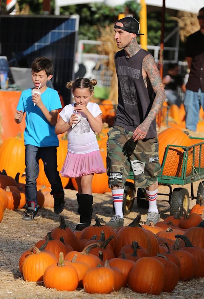 It might be cooling off in other parts of the country, but in L.A. it's still pretty hot! Blink 182 drummer Travis Barker treated his kids, Landon, 9, and Alabama, 6, to some icy treats during their visit to the pumpkin patch. (10/18/2012)