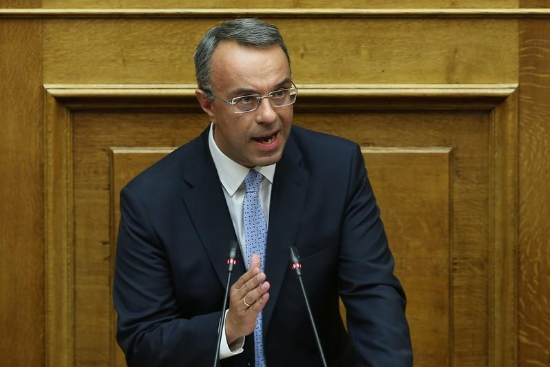 Greek Finance Minister Christos Staikouras speaks during a parliamentary session before a confidence vote on government policies in Athens