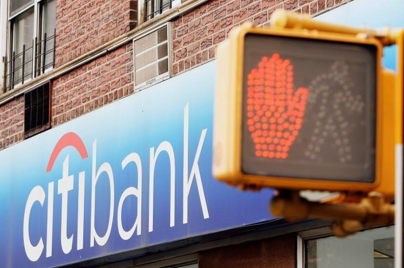 FILE PHOTO: Pedestrian signals can be seen outside of a Citibank branch in New York