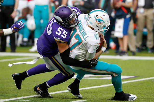 Miami Dolphins quarterback Ryan Tannehill is sacked by Minnesota Vikings outside linebacker Anthony Barr. (AP)