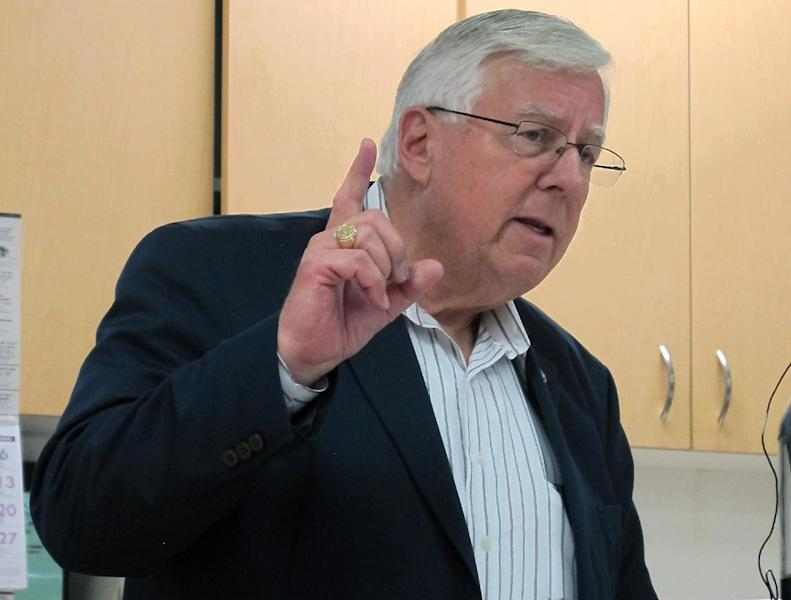 This July 2,2013 photo shows U.S. Sen. Mike Enzi, R-Wyo., speaks to constituents at a senior center in Pine Bluffs, Wyo. Enzi announced Tuesday, July 16, 2013, that he will run for re-election to the Senate. Liz Cheney, daughter of former Vice President Dick Cheney, said she will challenge him in the 2014 Republican primary. (AP Photo/Ben Neary)