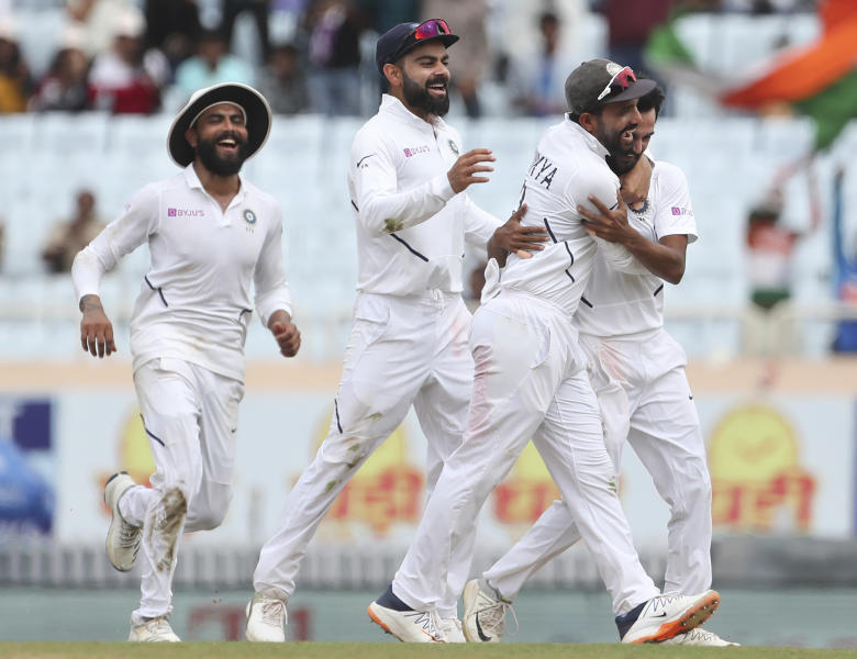 India's Sahbaz Nadeem, right, celebrates with teammates the dismissal of South Africa's Temba Bavuma during the third day of third and last cricket test match between India and South Africa in Ranchi, India, Monday, Oct. 21, 2019. (AP Photo/Aijaz Rahi)