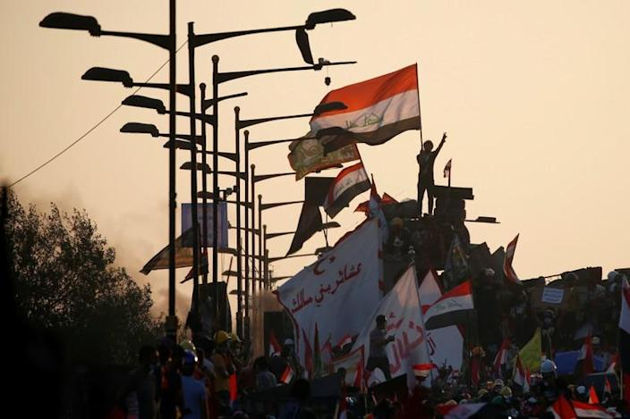 Iraqi demonstrators attend an anti-government protest in Baghdad