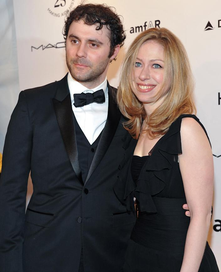 FILE- In this Feb. 9, 2011 photo, Chelsea Clinton and her husband Marc Mezvinsky attend amfAR's annual New York Gala at Cipriani Wall Street in New York. Clinton announced that she is pregnant with the couple's first child on Thursday, April 17, 2014 while co-hosting a Clinton Foundation event with her mother, Former Secretary of State Hillary Rodham Clinton. (AP Photo/Evan Agostini, File)
