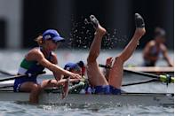 <p>Federica Cesarini and Valentina Rodini of Italy react after winning the gold medal during the lightweight women's double sculls final.</p>