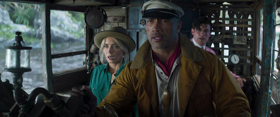"""Frank Wolff (Dwayne Johnson, center) takes Lily (Emily Blunt) and MacGregor (Jack Whitehall) on one heck of a ride in Disney's """"Jungle Cruise."""""""