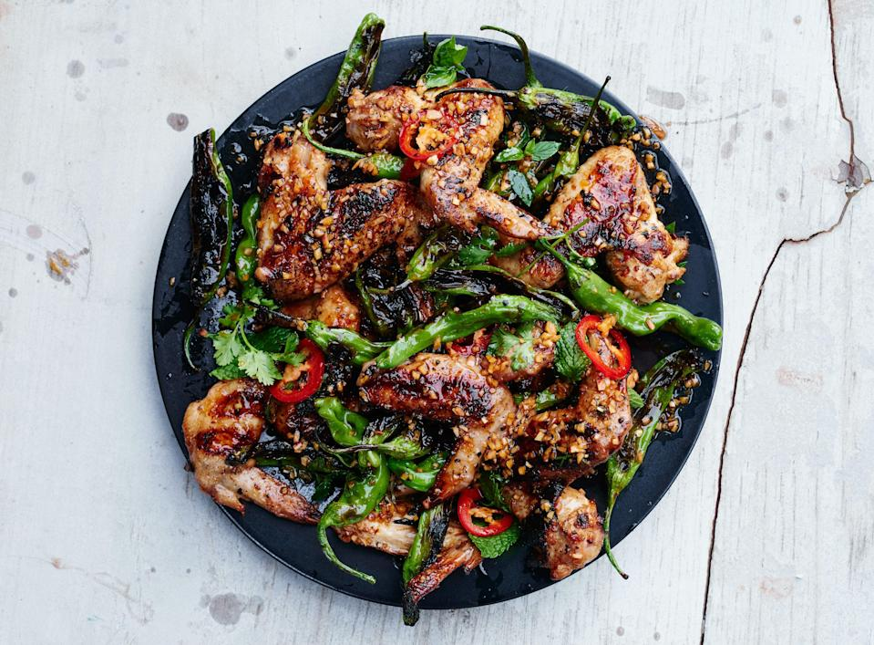 "Steady medium heat is best for grilling wings; they need time for the fat to render and the skin to crisp. <a href=""https://www.bonappetit.com/recipe/grilled-chicken-wings-with-shishito-peppers-and-herbs?mbid=synd_yahoo_rss"" rel=""nofollow noopener"" target=""_blank"" data-ylk=""slk:See recipe."" class=""link rapid-noclick-resp"">See recipe.</a>"