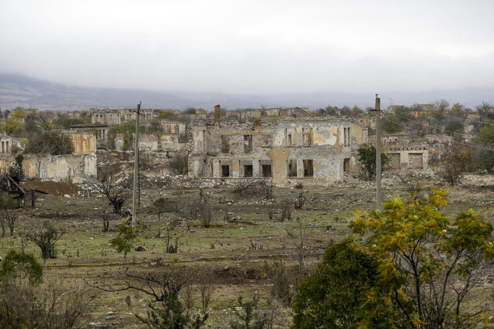 "A view of a vast expanse of jagged concrete and houses reduced to shells in Agdam, prior to the Azerbaijani forces being handed control in the separatist region of Nagorno-Karabakh, Thursday, Nov. 19, 2020. Although regaining Agdam is a triumph for Azerbaijan, the joy of returning is shot through with grief and anger. What was once a notably pleasing city of 50,000 known for its white homes and an elaborate three-story teahouse is so ruined that it's sometimes called the ""Hiroshima of the Caucasus."" (AP Photo/Sergei Grits)"