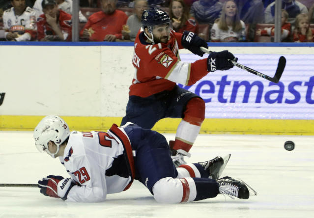 Florida Panthers center Vincent Trocheck (21) shoots on goal as Washington Capitals defenseman Christian Djoos (29) falls to the ice during the second period of an NHL hockey game, Monday, April 1, 2019, in Sunrise, Fla. (AP Photo/Lynne Sladky)