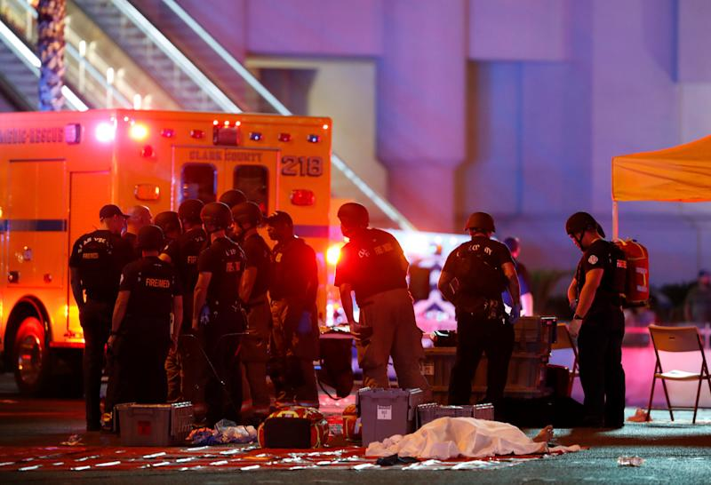 First responders gather near a victim of themass shooting in Las Vegas on Oct. 1, 2017. (Steve Marcus/Reuters)