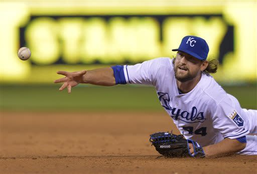 Kansas City Royals relief pitcher Luke Hochevar tossed the ball to first after running down a grounder by Cleveland Indians' Michael Brantley, who made it safe to first during the sixth inning of a baseball game Monday, April 29, 2013, in Kansas City, Mo. (AP Photo/Reed Hoffmann)