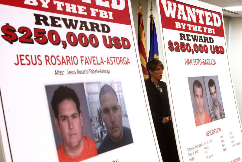 Laura E. Duffy, United States Attorney Southern District of California, is flanked by wanted posters as she speaks at a news briefing where Duffy announces the indictment of five suspects related to the death of U.S. Border Patrol agent Brian Terry, Monday, July 9, 2012, in Tucson, Ariz. A reward of up to $1 million dollars for information leading to the arrest of four fugitives was also announced by Department of Justice officials, on suspect is in custody.(AP Photo/Ross D. Franklin)