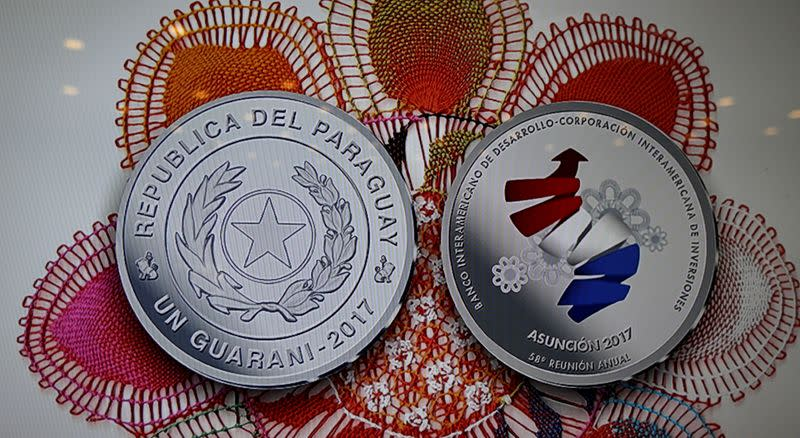 FILE PHOTO: The commemorative coin of the 58th Annual Meeting of the Board of Governors of the Inter-American Development Bank is seen on a screen in Luque