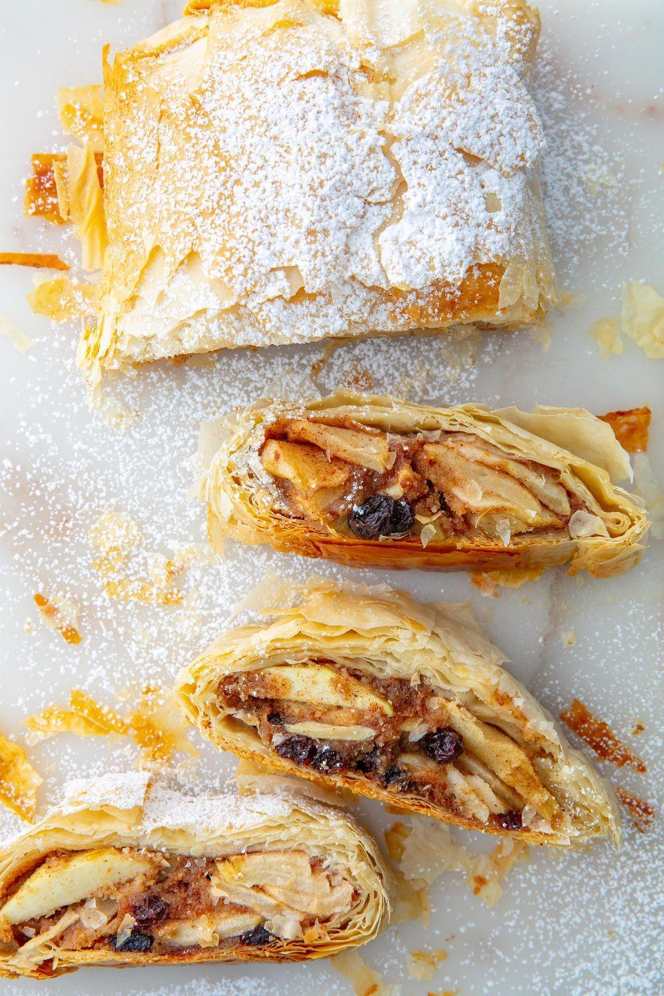 """<p>What even is a strudel?! We'll tell you because we're obsessed: A layered pastry with a gooey filling. </p><p>Get the recipe from <a href=""""https://www.delish.com/cooking/recipe-ideas/a21971647/easy-apple-strudel-recipe/"""" rel=""""nofollow noopener"""" target=""""_blank"""" data-ylk=""""slk:Delish"""" class=""""link rapid-noclick-resp"""">Delish</a>.</p>"""