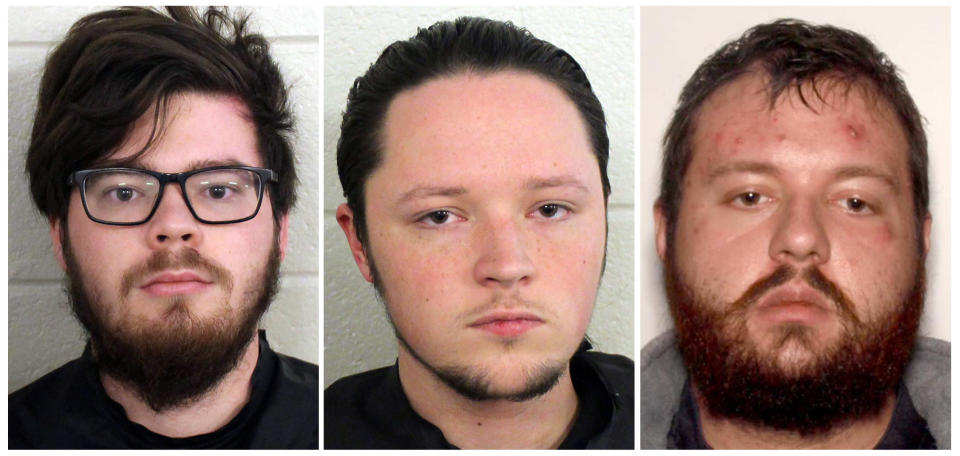 These undated photos provided by Floyd County, Ga., Police show from left, Luke Austin Lane of Floyd County, Jacob Kaderli of Dacula, and Michael Helterbrand of Dalton, Ga. FBI spokesman Kevin Rowson said Friday, Jan 20, 2020, that agents assisted in the arrests of the three Georgia men linked to The Base, a violent white supremacist group, on charges of conspiracy to commit murder and participating in a criminal street gang. Details of their cases have been sealed by a judge, Floyd County police Sgt. Chris Fincher said. (Floyd County Police via AP