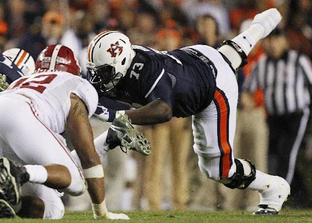 FILE - In this Nov. 30, 2013, file photo, Auburn offensive linesman Greg Robinson (73) blocks during the second half of an NCAA college football game against Alabama in Auburn, Ala. Robinson is a two-year starter at left tackle who became a dominant player as a junior last year. He is a top prospect in the upcoming NFL draft. (AP Photo/Butch Dill, File)