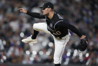 Colorado Rockies relief pitcher Tyler Kinley works against the Milwaukee Brewers during the eighth inning of a baseball game Thursday, June 17, 2021, in Denver. (AP Photo/David Zalubowski)