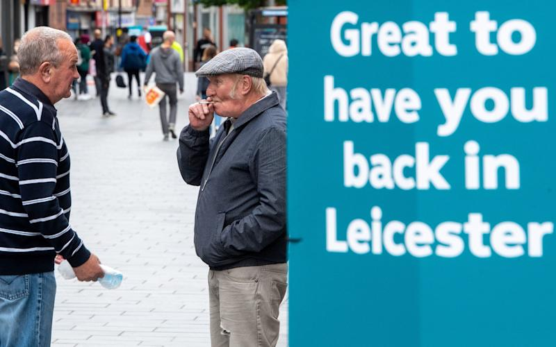 Signs in the centre of Leicester welcoming people back to the city - Joe Giddens/PA