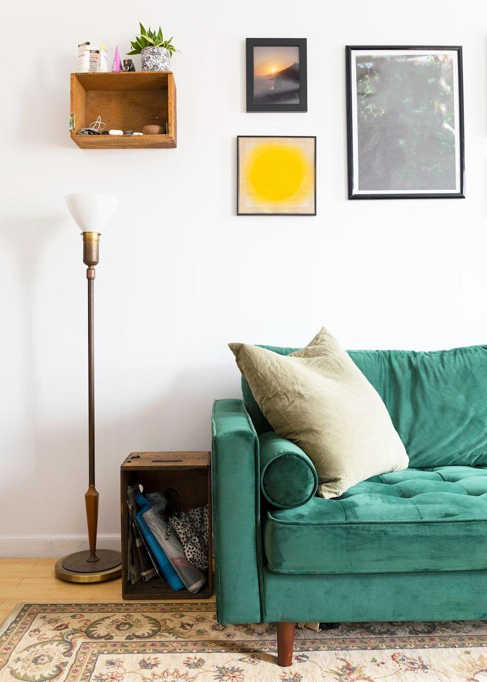 <p>Why settle for floating shelves when you can secure a floating cubby to the wall? In this living room, it strikes the balance between bohemian and polished. </p>