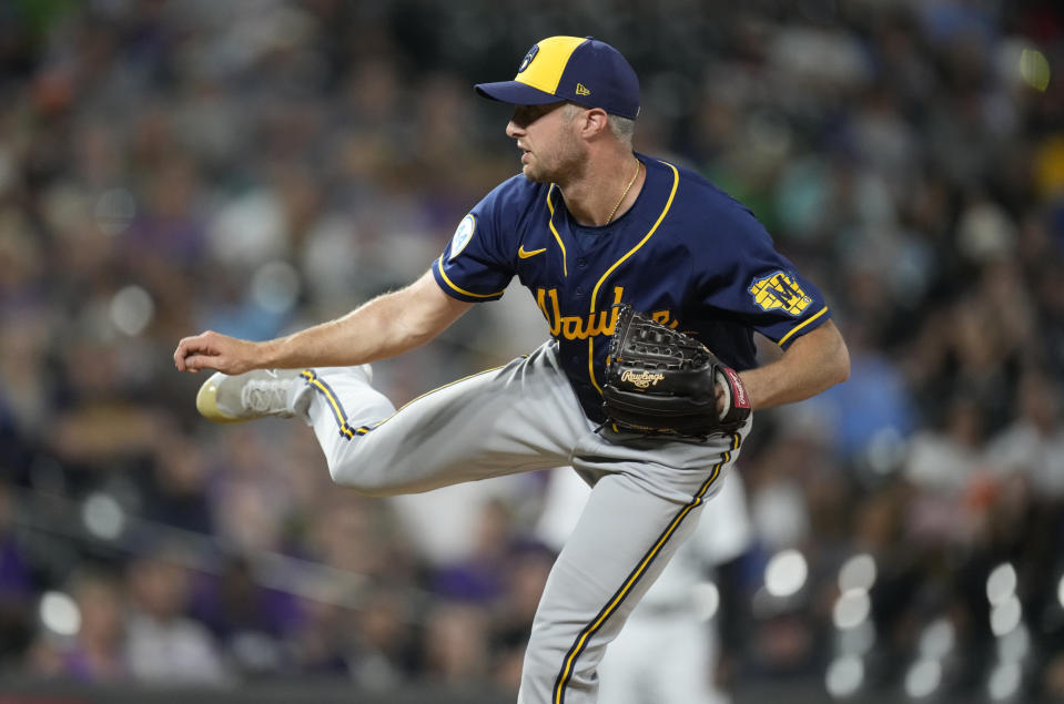 Milwaukee Brewers relief pitcher Trevor Richards works against the Colorado Rockies during the eighth inning of a baseball game Friday, June 18, 2021, in Denver. (AP Photo/David Zalubowski)