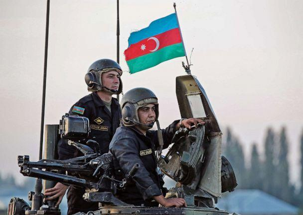 PHOTO: Azerbaijani soldiers look on from a tank during a training at a military training and deployment center near the city of Ganja, Azerbaijan, October 23, 2020. (Umit Bektas/Reuters)