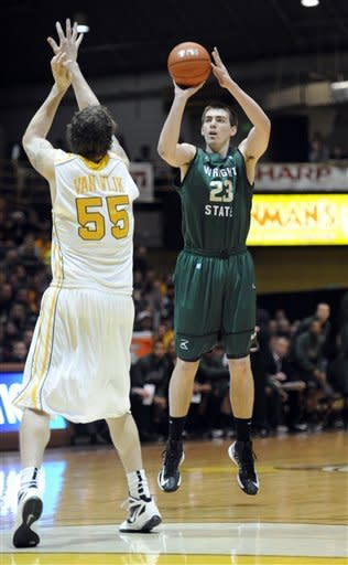 Wright State forward AJ Pacher, right, puts up a shot over Valparaiso forward Kevin Van Wijk during the first half of an NCAA college basketball game in the final of Horizon League Conference tournament Tuesday March 12, 2013 in Valparaiso, Ind. (AP Photo/Joe Raymond)