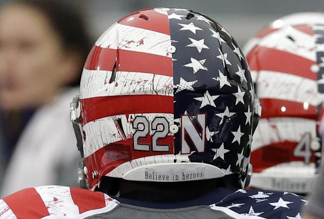 Northwestern running back Treyvon Green wears the Wildcats New patriotic-themed uniform and helmet before an NCAA college football game against Michigan in Evanston, Ill., Saturday, Nov. 16, 2013. (AP Photo/Nam Y. Huh)