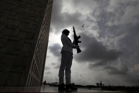 A cadet of the Pakistan Navy, positions during a ceremony to celebrate Pakistan's 72nd Independence Day in Karachi