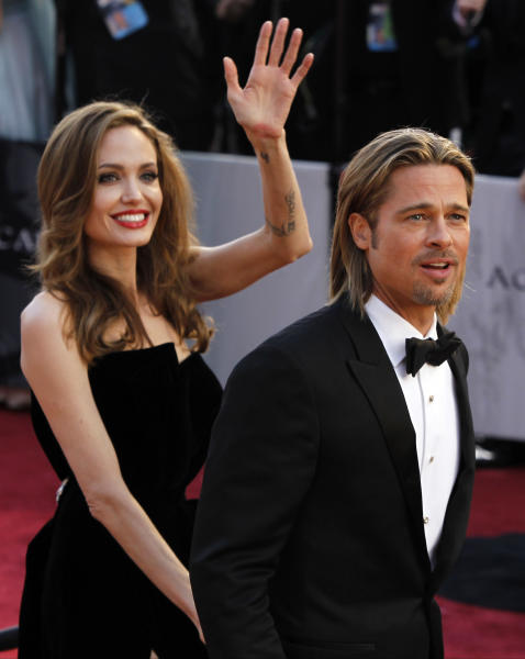 Actor Brad Pitt, right, and actress Angelina Jolie arrive before the 84th Academy Awards on Sunday, Feb. 26, 2012, in the Hollywood section of Los Angeles. (AP Photo/Joel Ryan)