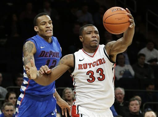 Rutgers' Wally Judge (33) recovers the ball after blocking a shot by DePaul's Cleveland Melvin (12) during the second half of an NCAA college basketball game at the Big East Conference tournament, Tuesday, March 12, 2013, in New York. (AP Photo/Frank Franklin II)