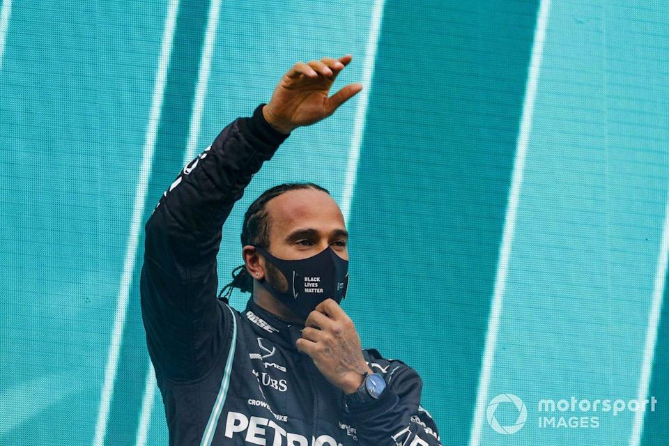 "Lewis Hamilton, Mercedes-AMG F1, waves on the podium after winning the race, to take his 7th World Championship title<span class=""copyright"">Steven Tee / Motorsport Images</span>"