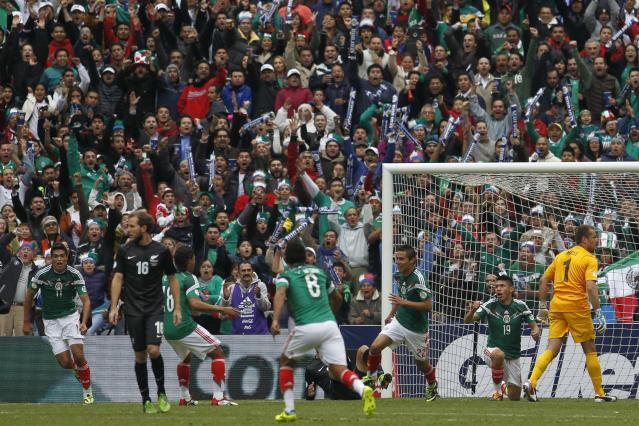 Mexico's Paul Aguilar (3rd R) celebrates his goal during their 2014 World Cup qualifying playoff first leg soccer match against New Zealand at Azteca stadium in Mexico City November 13, 2013. REUTERS/Edgard Garrido (MEXICO - Tags: SPORT SOCCER WORLD CUP)