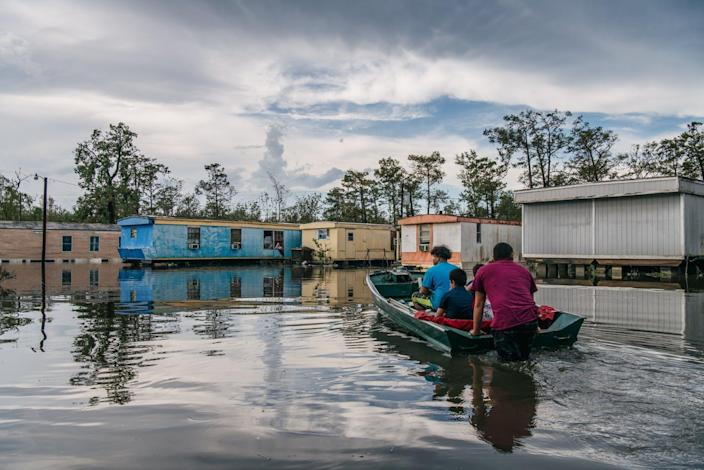 """<span class=""""caption"""">""""My family has lost everything. We all live in this area, and now it's all gone,"""" said Fusto Maldonado, whose home in Barataria, Louisiana, flooded during Hurricane Ida.</span> <span class=""""attribution""""><a class=""""link rapid-noclick-resp"""" href=""""https://www.gettyimages.com/detail/news-photo/the-maldonado-family-travel-by-boat-to-their-home-after-it-news-photo/1337537259"""" rel=""""nofollow noopener"""" target=""""_blank"""" data-ylk=""""slk:Brandon Bell/Getty Images"""">Brandon Bell/Getty Images</a></span>"""