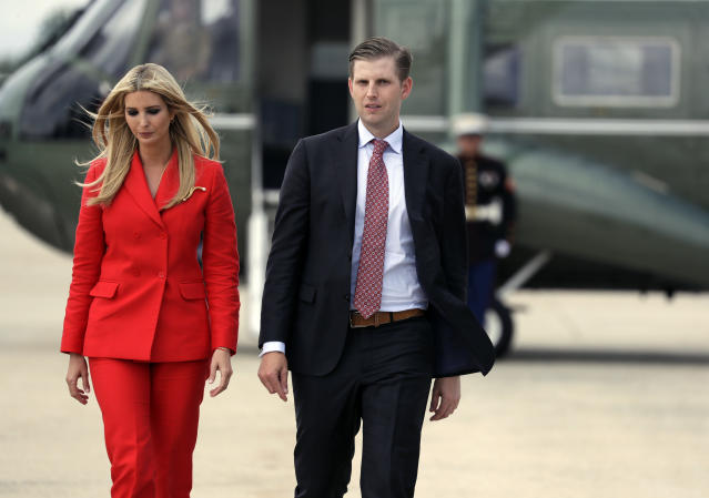 Ivanka Trump wore a red Sandro suit as she joined brother Eric for the Florida trip. (Photo: AP Photo/Evan Vucci)