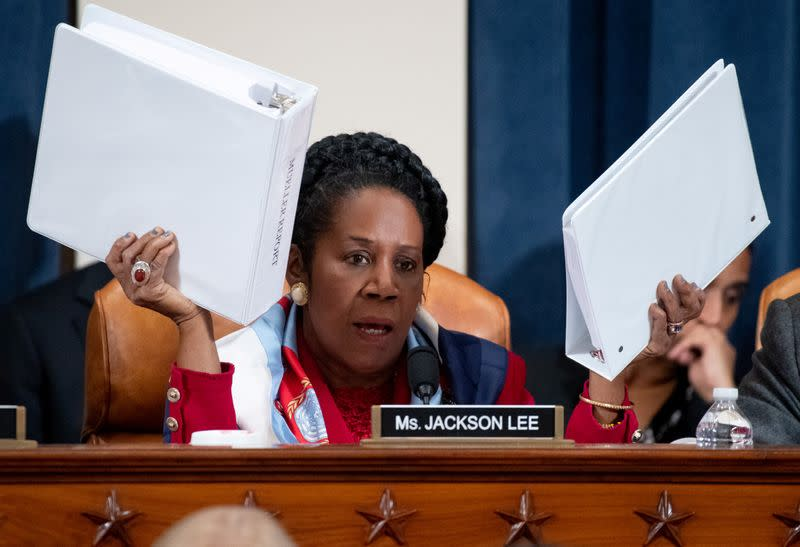 U.S. Representative Sheila Jackson Lee holds up copies of the Mueller Report as she questions constitutional scholars during a House Judiciary Committee hearing on the impeachment Inquiry into U.S. President Donald Trump on Capitol Hill