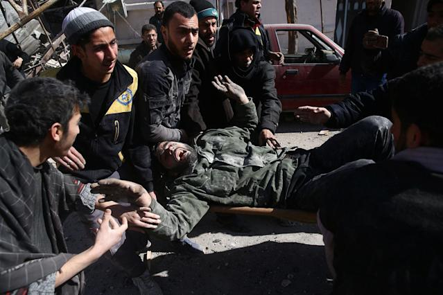 <p>A man reacts as he is carried on a stretcher after an airstrike in the besieged town of Douma in eastern Ghouta in Damascus, Syria, Feb. 7, 2018. (Photo: Bassam Khabieh/Reuters) </p>